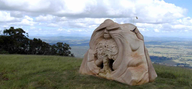 Visiting Earth Angel - sculpture created by Antone Bruinsma at Stonesong Sculpture Symposium - Mount Tamborine